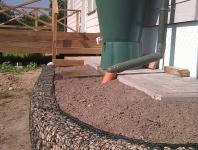"""Lietaus vandens paskirstymo """"taškas"""": vandens surinkimo talpai užsipildžius, perteklinis vanduo grąžinamas į gruntą"""